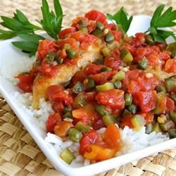 This recipe is a variation on traditional chicken piquant which is spicy Cajun chicken. This comes together quickly and is good served over white rice!