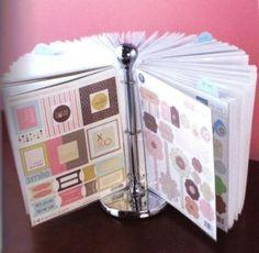 use a paper towel holder and binder clip and this is a neat and cute way to have your scrapbook pages on display