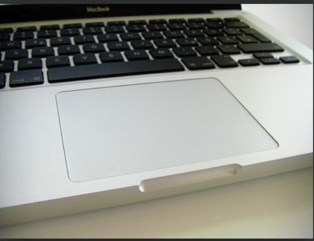 If you've spilt a bit of liquid on your MacBooks track pad firstly turn the laptop off. Then use the corner of a receipt or just paper and slide it down the each side of the track pad and slide along a few times. after doing this leave the Mac for about 10 minutes and it should be working fine 😊