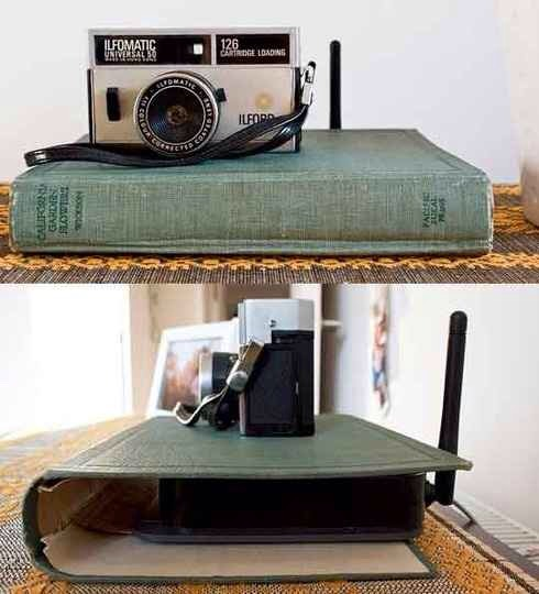 5. Use a hollowed-out book to hide an unsightly router. If you're averse to the idea of desecrating books for the sake of home decor, try using a binder or a pretty photo album instead.