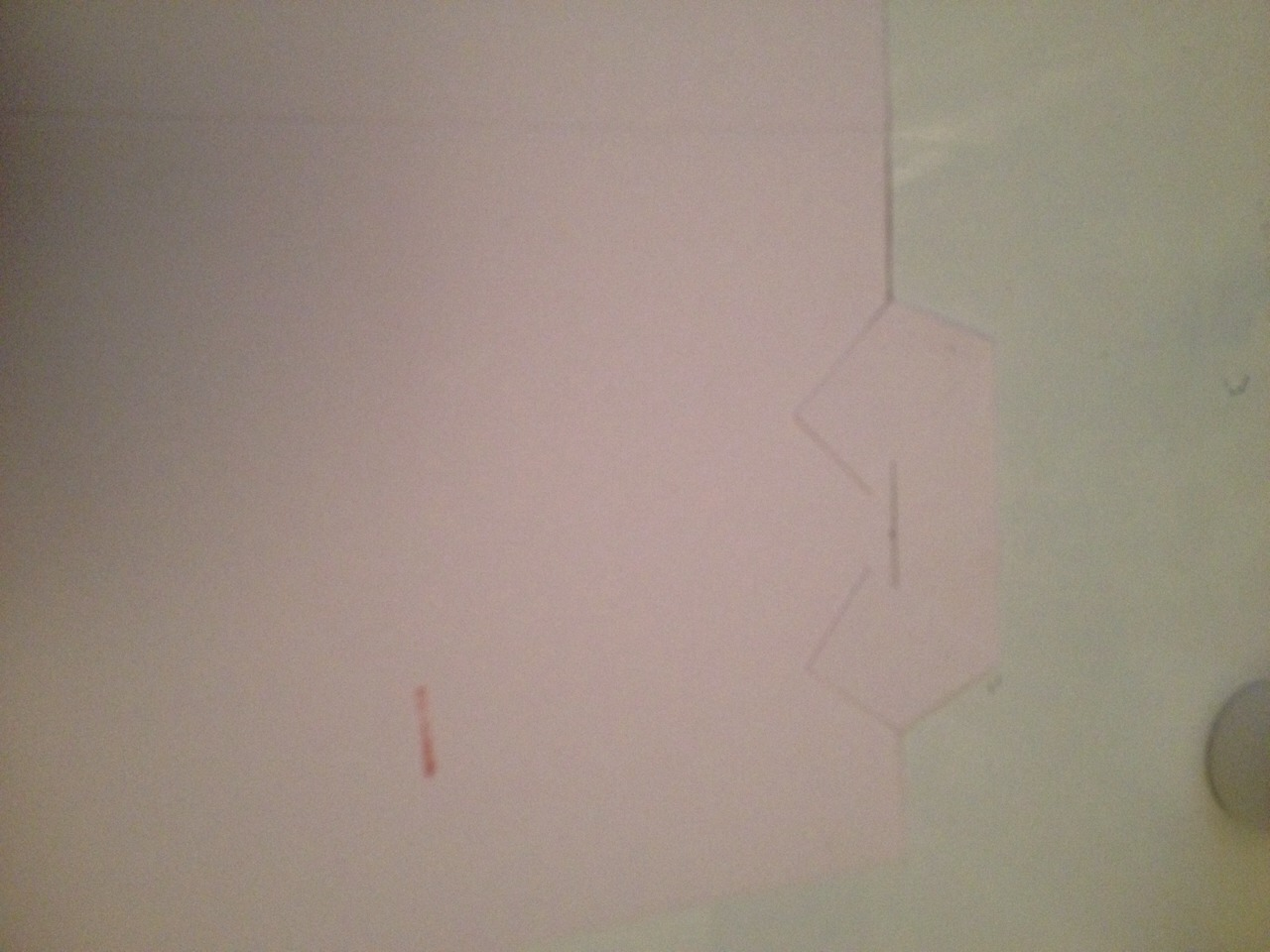 Make a snip 2.3cm from each side and stick them down