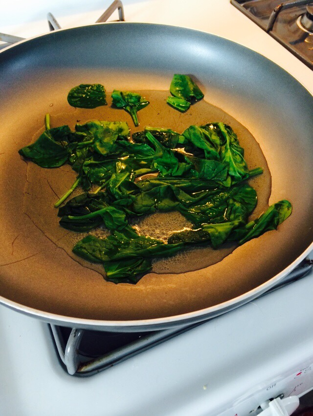 In a small fry pan, Add 4 tablespoons water and the spinach, cover and wilt. This will only take a few minutes at 3 on gas stove.