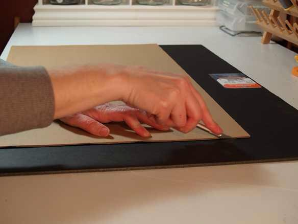 I bought a large, cheap frame at Michaels and took out the glass. I then measured a piece of foam board to fit the frame.