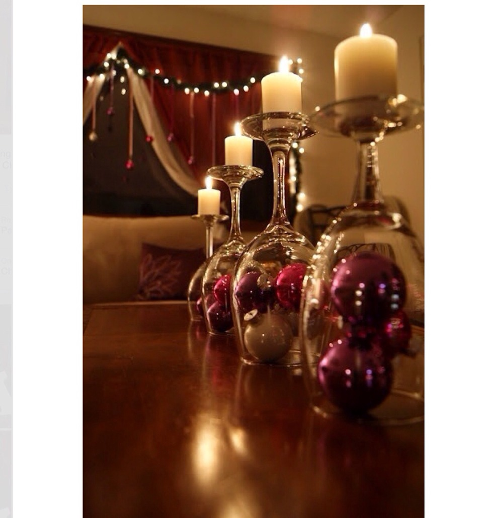 Get any kind of Christmas ornament and put it under the wine glass and put the candle on the bottom that is facing up. Looks cute, adorable, and is very easy to do.