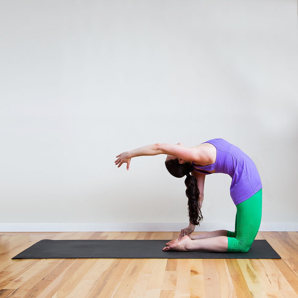 One armed camel pose