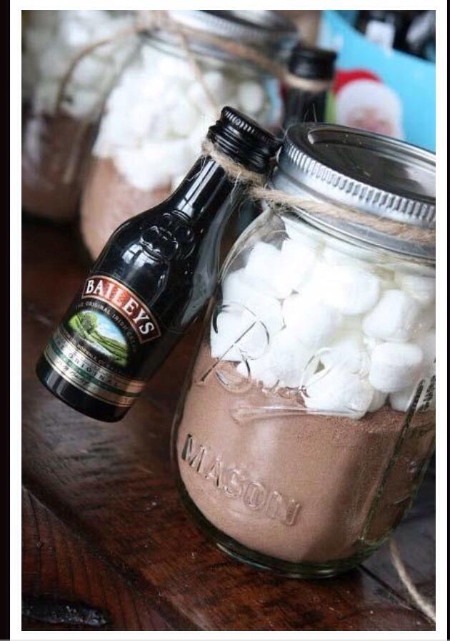 Full mason jar with hot cocoa marshmallows and tie a little jar of baileys Irish cream for good luck!