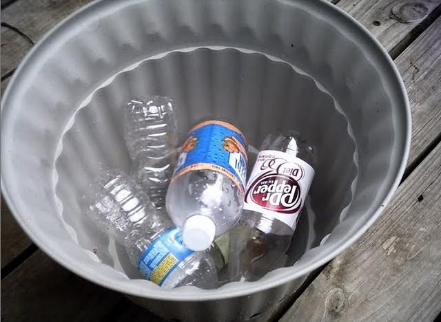 Instead of putting rocks in the bottom of big porch planters, fill the bottom with sealed empty plastic 20 ounce bottles! They give the pot the drainage it needs, without adding all that extra weight! So smart!!