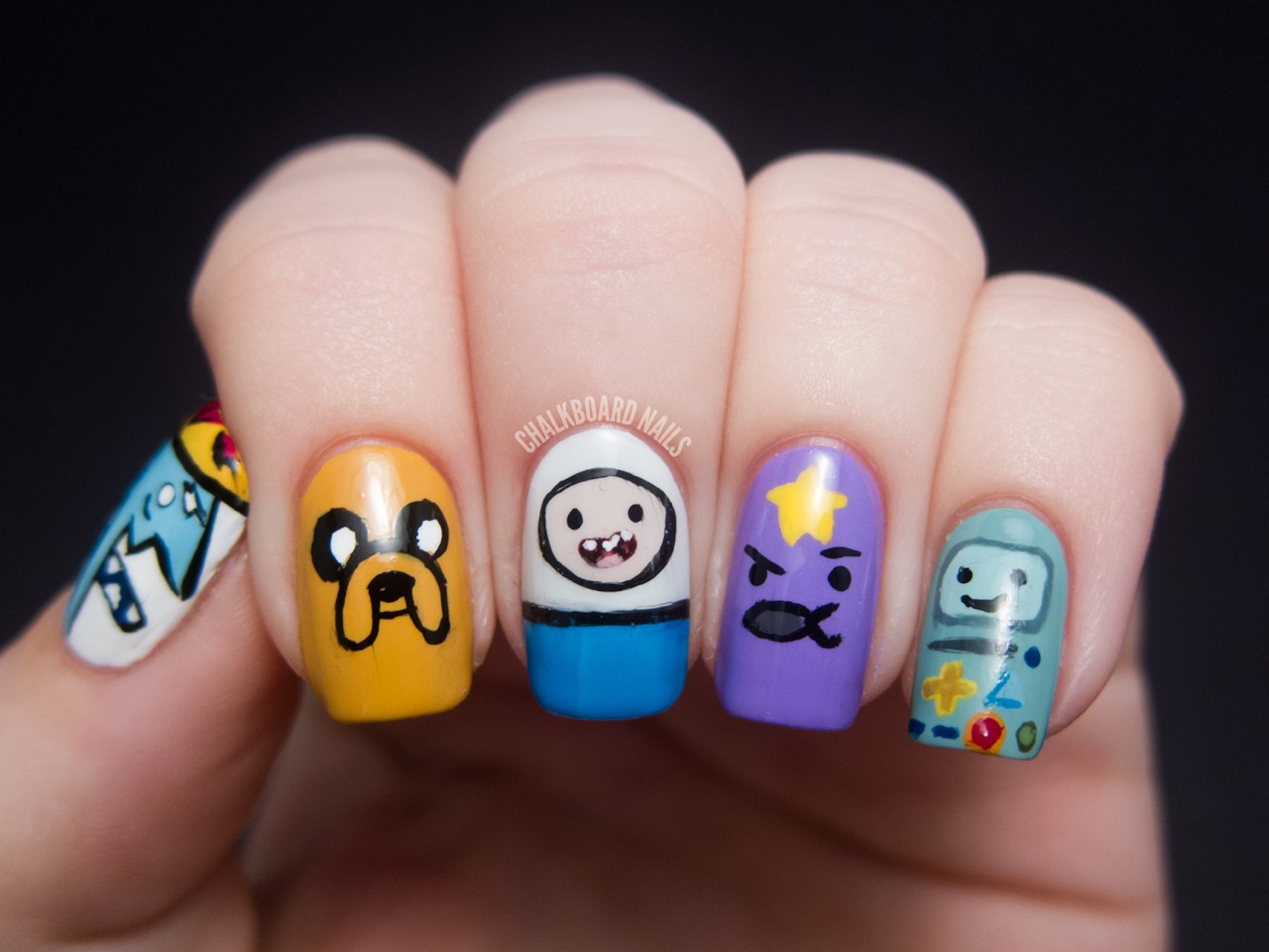 What time is it? Time to put your favorite Adventure Time characters on your nails! Use lots of vibrant polishes to recreate your favorite characters. Do just an accent nail or do every nail with a different character. So many cute combos!