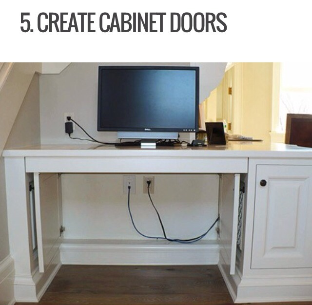This is a perfect way to hide cords that come out from under your desk. Simple install hinges and cabinet doors to create a stylish hiding space for your wires. The cabinets still allow you to move and change everything you need while still letting you hide it all-plus it hides the electrical socket