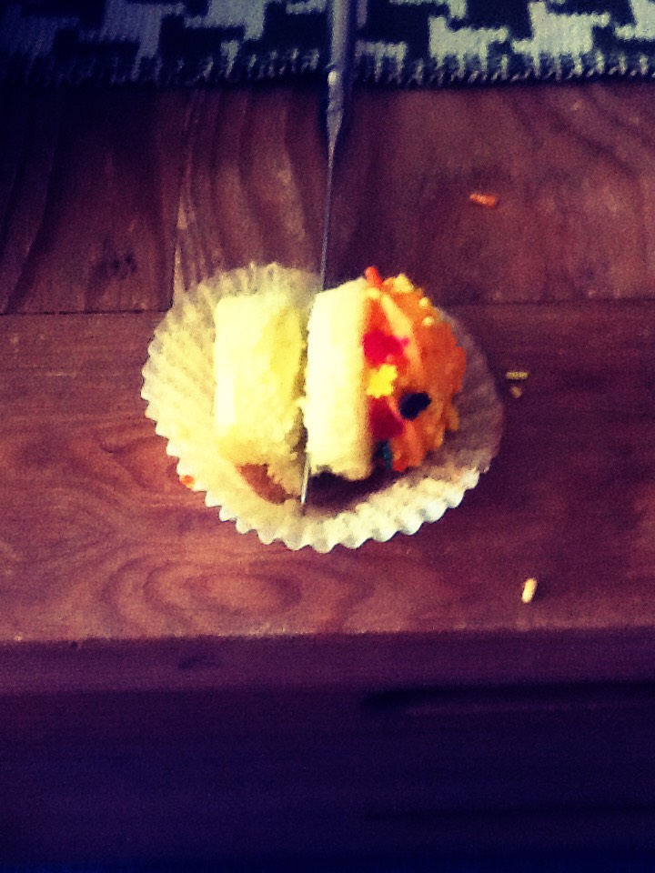 Then cut the cake half of the cupcake in half