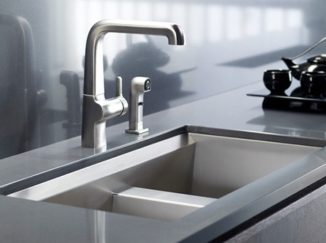 Go to a sink where u don't mind temporary (5 minute) gasoline smell  and make sure the drain is closed  pour some gasoline and rinse hands with rag or towel