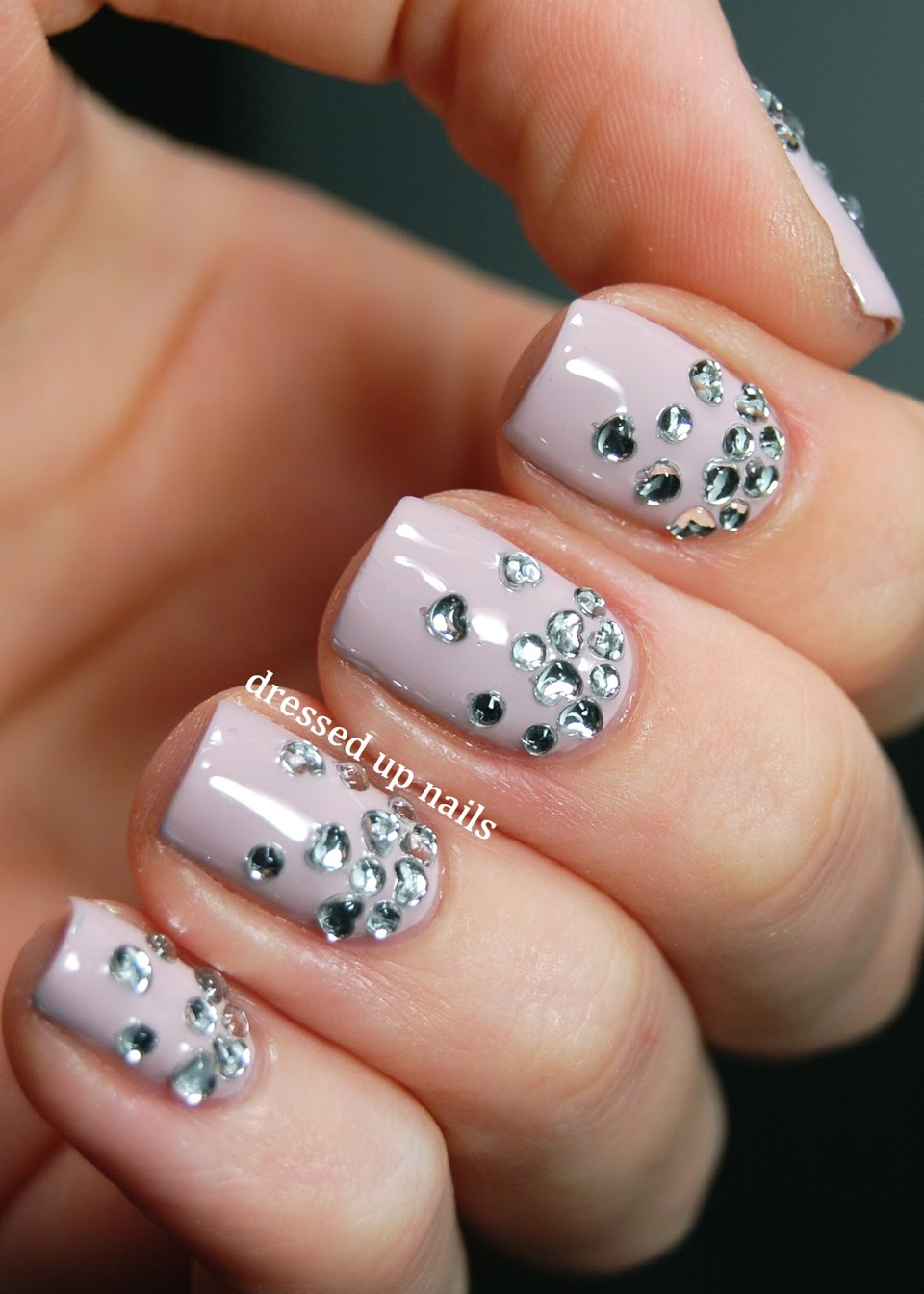 Gems always make your nails look stylish, along with this colour they look fab!