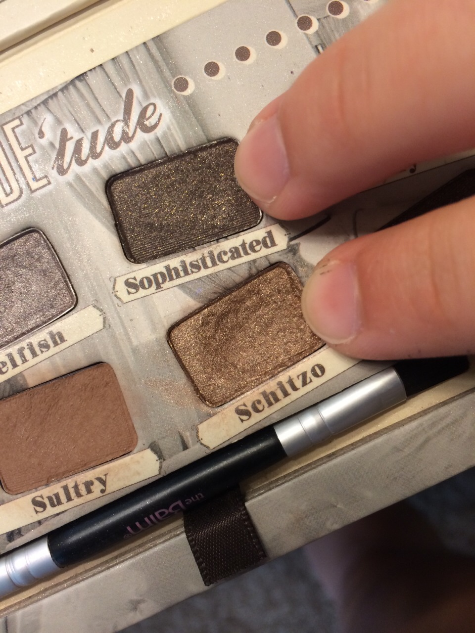 Next, apply a neutral color (I prefer shimmery and either dark or light brown) to the outside corner of you eye and the crease of you eye with the same brush. Again, do not forget to tap off the excess eyeshadow.