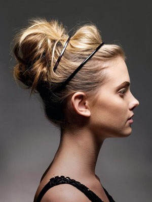 Casual updo!  Pull hair up into a pony then take sections and wrap loosely around elastic and pin. Add bands or braids to create some interest