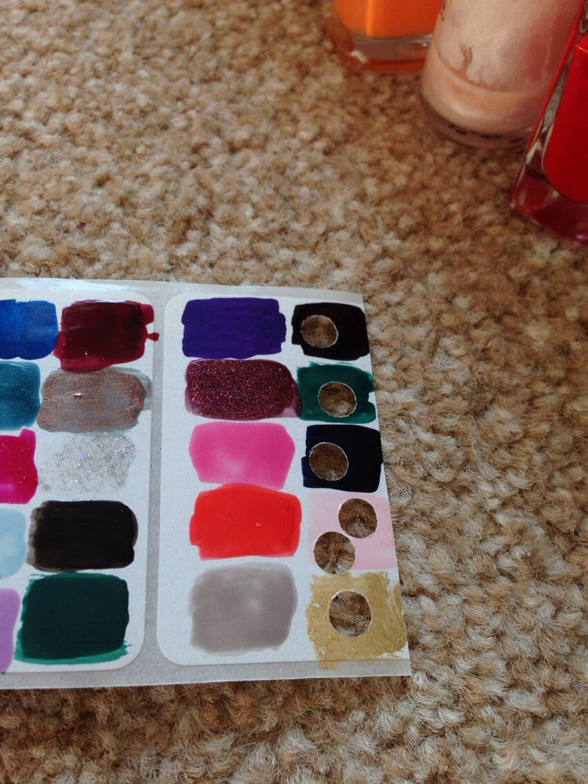 Paint little squares of nail polish on sticky labels and wait for it to dry