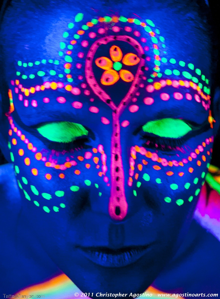 Simply use a non toxic highlighter!!! It will barely show up in the light, but once you go into the black light, it will look like this!!! Have fun and be creative with all your black light tattooes!