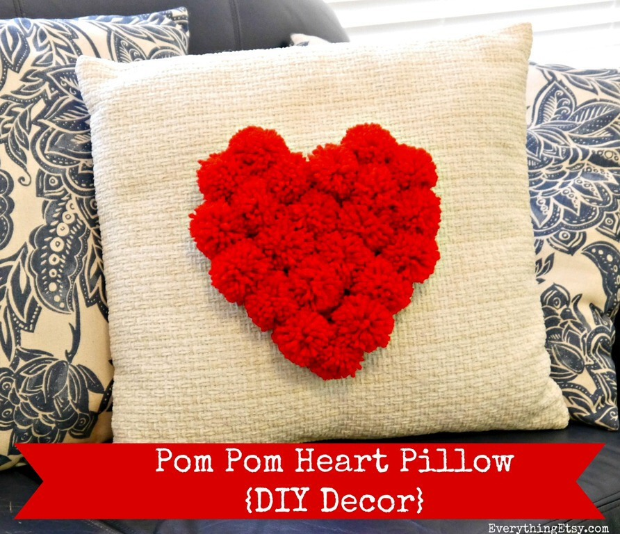 Cute Pom Pom pillow !  Supplies needed: red/pink Pom Poms, old pillow,glue gun!
