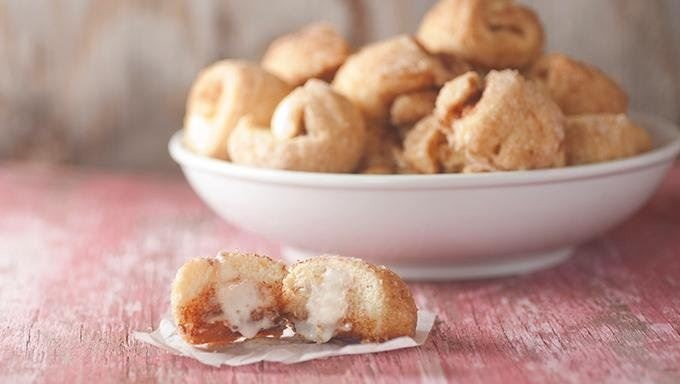 INGREDIENTS  1 package Pillsbury Flaky Cinnamon Twists  1/4 cup Betty Crocker Creamy White Frosting  3/4 cup granulated sugar  2 teaspoons ground cinnamon  1/4 cup melted butter  1/4 cup caramel ice cream topping, warmed