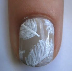 Using the same brush add more paint to the tip of the brush and start sketching the test of the leaf. Soon enough your left with a beautiful leaf detail on your nail.
