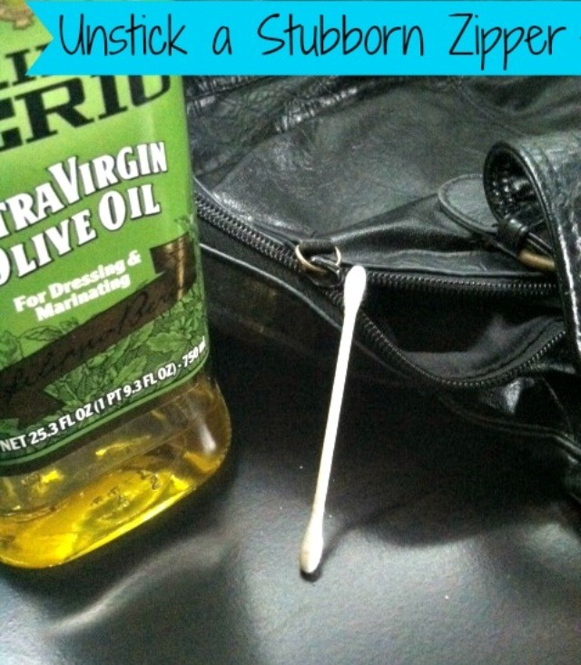 Dip a q-tip into some olive oil. Rub around the zipper and teeth. This will slowly lubricate the zipper and free it!