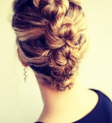 Cute twirls! Step#1: part your hair into 4 sections horizontally. Step#2: take the very top section and twist the hair making a lil twirl - use bobby pins or u pins to hold in place Step#3: for the following sections do the same..
