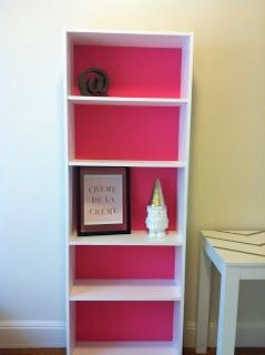 Adding a pop of color to the back panel of book shelves really adds to the decor!