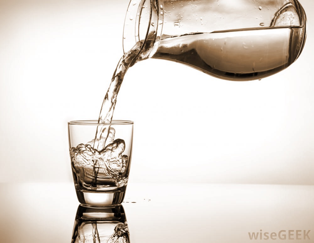 First of all, drink lots of water. It moisturizes your throat and helps you sing better.