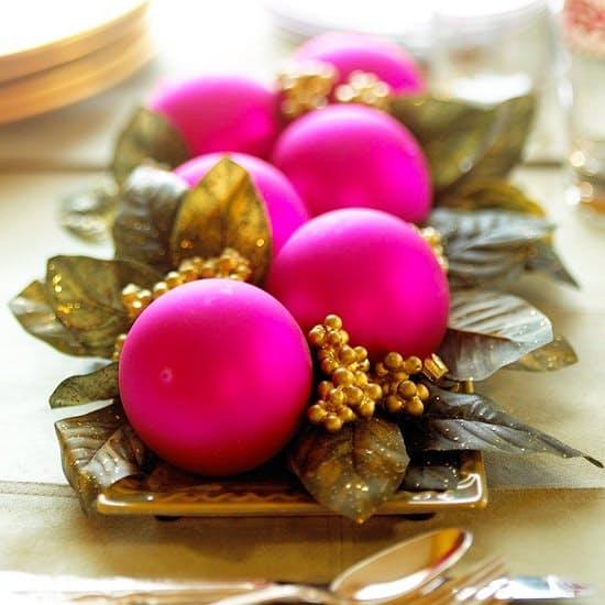 Lastly, some pretty ornaments sitting on a bed of simple greens, as seen inBetter Homes and Gardens,make for a classy addition to your table.