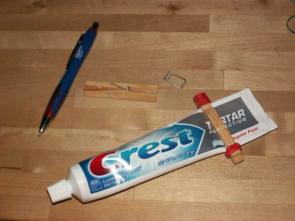 Take spring out of clothes pin and put them at the end of toothpaste tube the simply attach by using rubber bands on each side.  Then slide as you go. Thanks for looking. Please don't forget to like and follow. Click my profile pic to see all my tips.