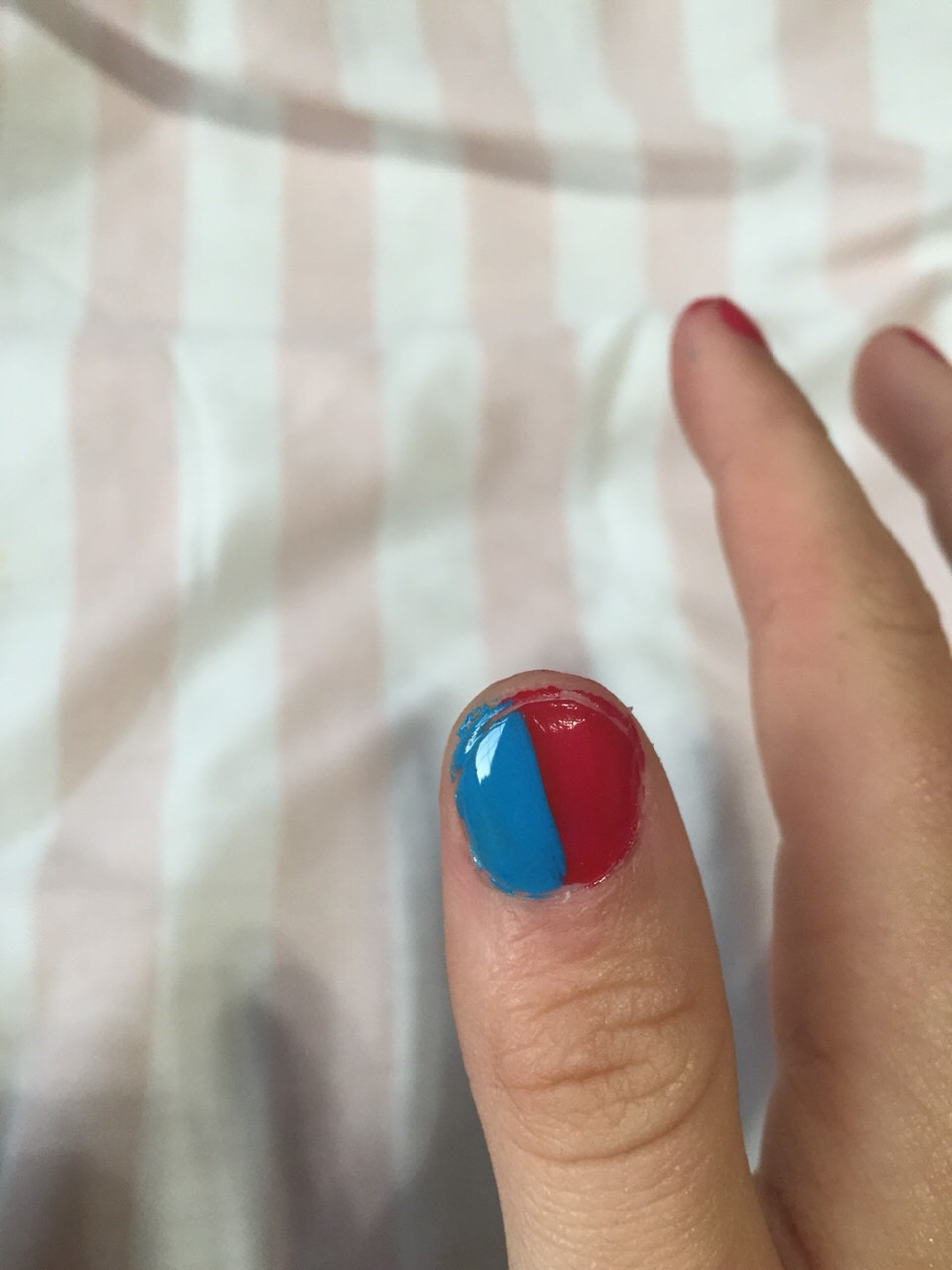 Paint the other 1/2 of your thumb blue