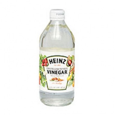 Pour a teaspoon on vinegar into the boiling pot of water.