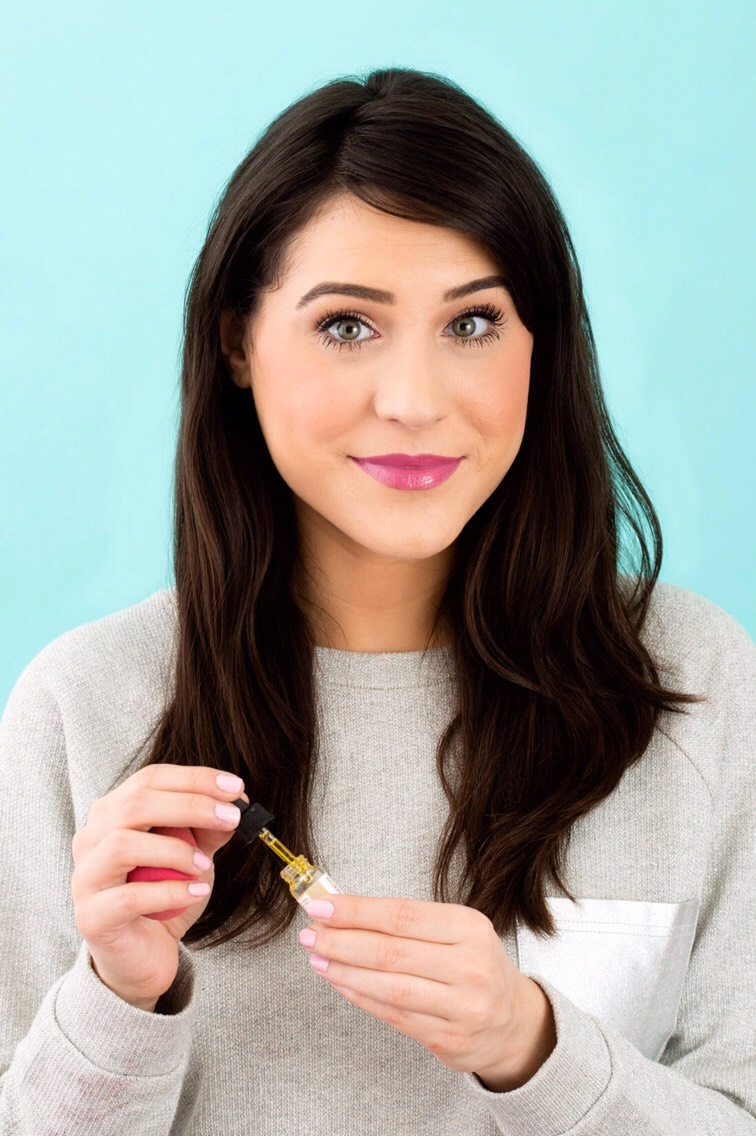 After applying your makeup carefully apply a dime-sized amount of oil to the top of your hand.(The key is to not overdo it, otherwise you'll look straight-up greasy.)