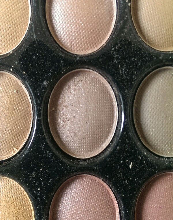 then add a dark shimmery brown on the bottom outer corner of the eye.
