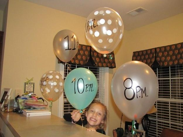 """4. Get activities going with a balloon schedule that """"pops"""" on the hour revealing what's on the agenda."""