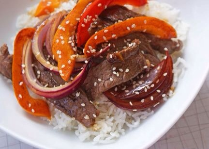 Beef and Pepper Stir Fry  My husband always orders Pepper Steak when we order Chinese. This lighter version made at home can be served over rice or noodles, or as a filling for lettuce wraps.