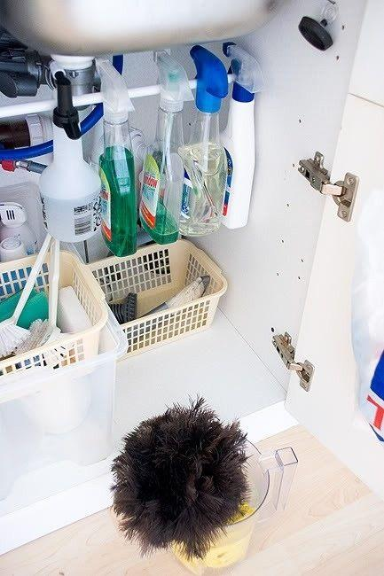 12. Under-Sink Rod Help free up some space and give those spray bottles easy access by placing a tension rod under your kitchen sink!