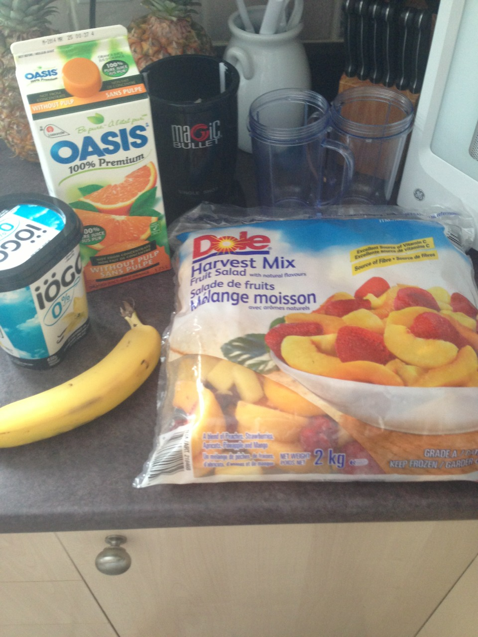 Ingredients  Frozen fruit( any kind works I'm using dole harvest mix) 1/2 a banana Any flavour of yogurt ( I'm using vanilla) Orange juice  And a blender the magic bullet works great!! It's easy to use and to clean!! Any blender will work though
