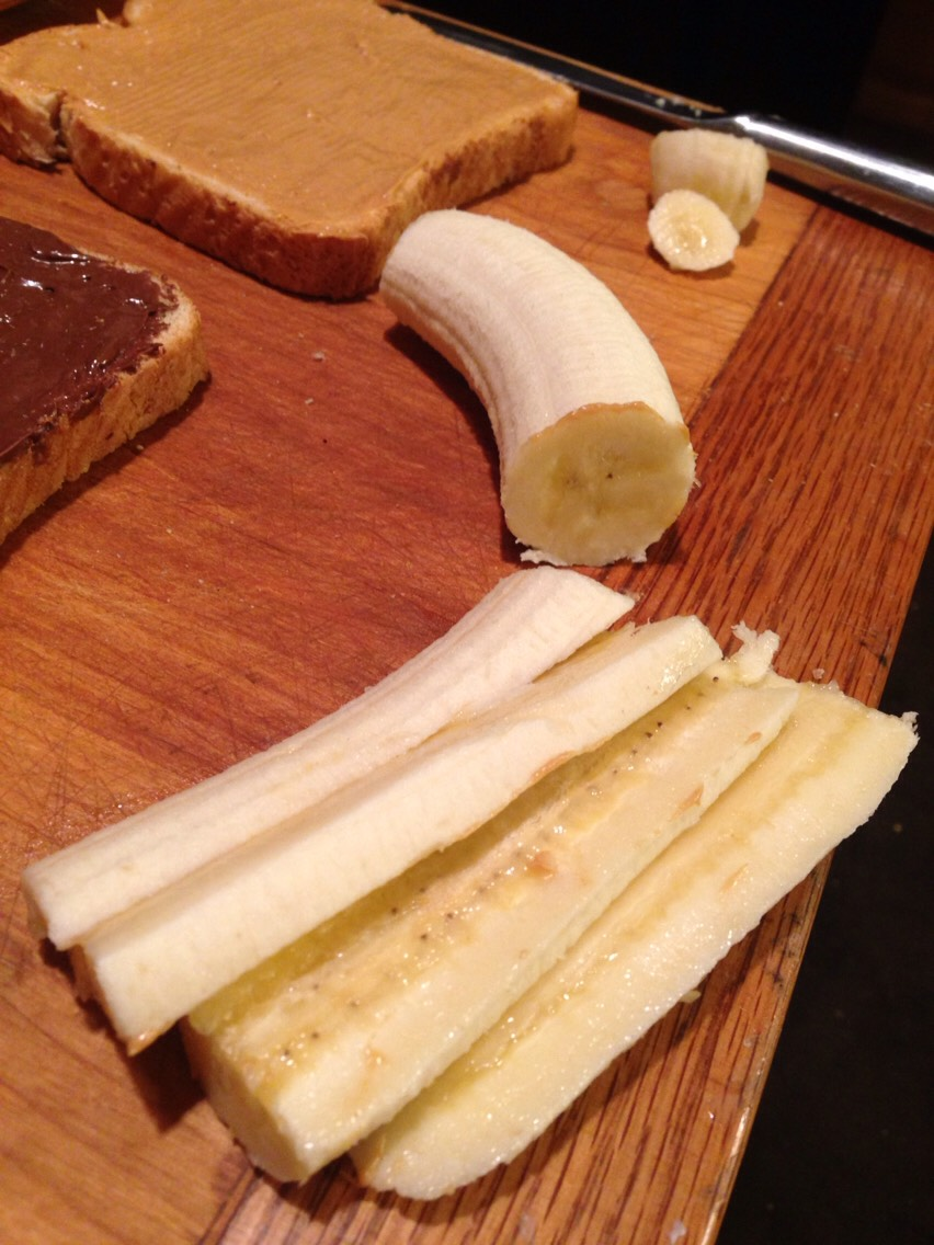 Then take a banana - cut it in half and then into slices