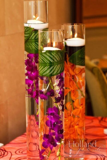 4. Tropical Oasis: Purchase a tall vase and fill it halfway up with water. Place fake flowers into the vase and put a floating candle on top.