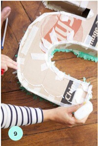9. Start at the bottom and draw the design in glue. Take the fringe and put down a layer.