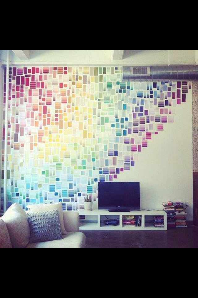 Take the free paint cards from stores, such as Home Depot, once you have enough cut them into smaller pieces and arrange on wall. You can apply with sticky tac or with clear sealer to make it a permanent arrangement