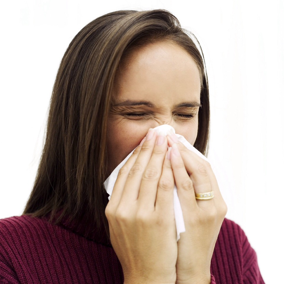 Most try to cover it but, I know a better way. Just hold your tongue up to the roof of your mouth (the top of your mouth on the inside), it won't stop it right a way, just hold your tongue there until you don't feel the sneeze coming anymore