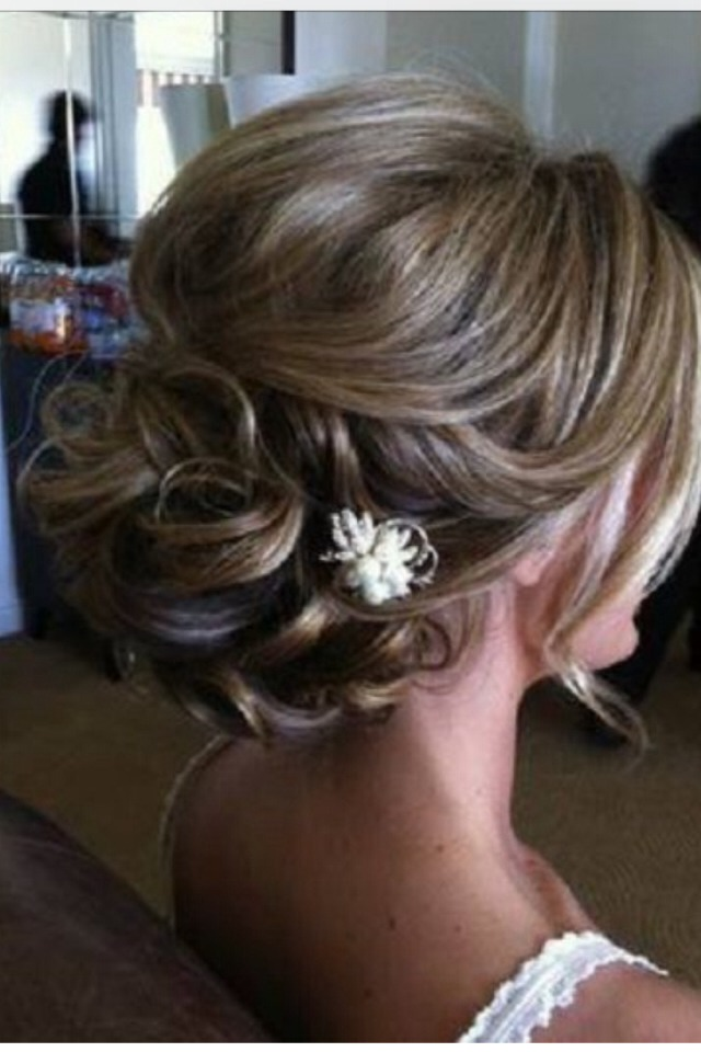 A curly updo with a flower pin.