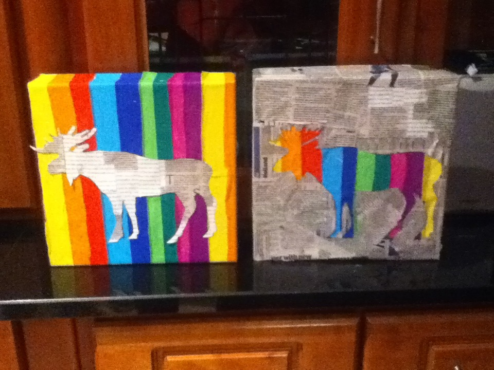 "This an example of artwork I've done using crepe paper and newspaper on 2 board game boxes!  ... I call it ""Rainbow Moose"" - Cian Charlton"