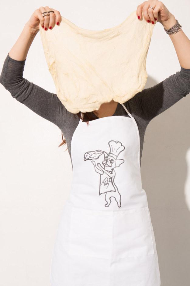 14. An apron to wear when you're tossing dough.