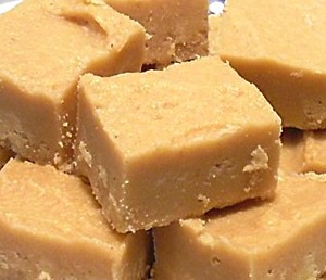 Easy peasy 2 ingredient fudge! All you need is an 18oz jar of peanut butter and a can of vanilla frosting. Heat can of frosting in microwave for 60 seconds. Combine frosting and peanut butter, then transfer to a wax paper lined baking dish and let chill in fridge till firm. And there you have it!