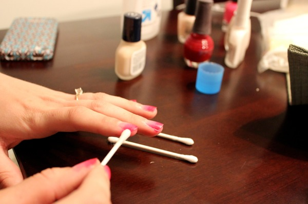 Apply nail polish remover on Qtip and remove polish thats on the skin