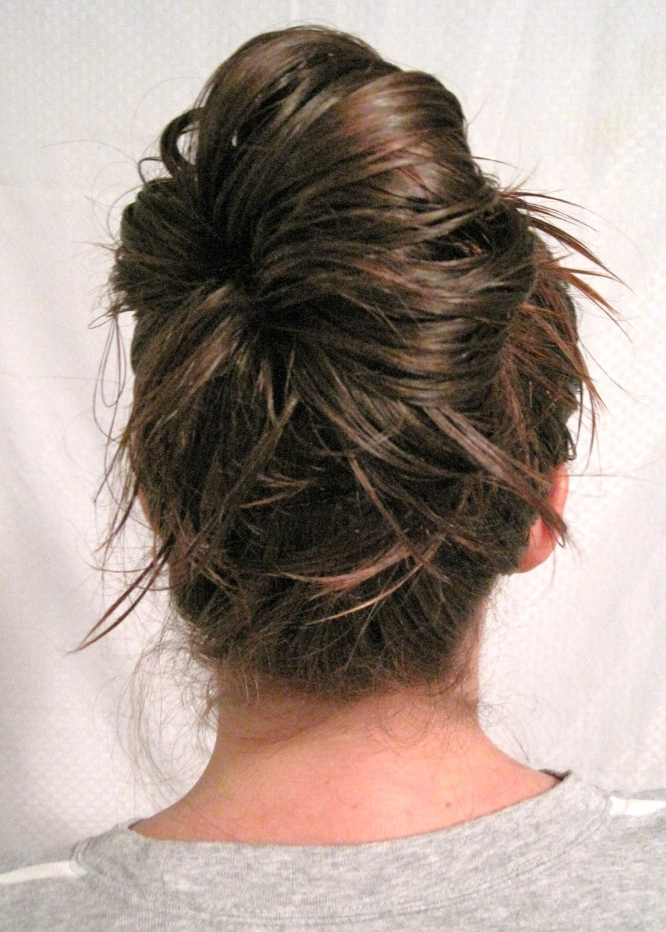 Once your moussed, damp hair, is in a bun... Go to sleep.  Make sure to put a towel over your pillow!