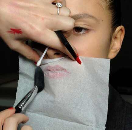 Put a tissue over your newly applied lipstick, then powder your lips over the tissue to create a matte look that lasts longer.