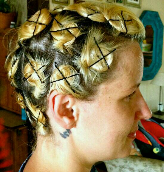 Take little bits of hair and twist them around your finger. Then, put it in a little bun and Bobby pin them down. Leave it like this for a couple of hours and you should have pretty curls